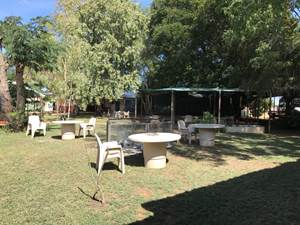Figure 1.1 & 1.2 (from left to right): View of the central outdoor area, including fire pit; and view of residents' room.