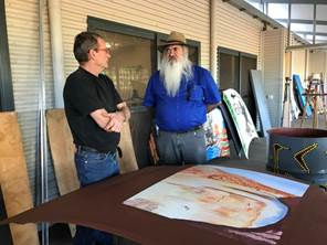 Figure 1.6 & 1.7 (from left to right); Senator Dodson speaks to the manager of the Yarliyil Arts Centre about the centre's current community project; and photo of some of the artworks which will be placed around Halls Creek.