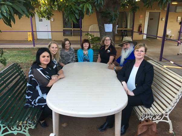 Figure 1.8: Photo of Senator Siewert, Senator Dodson, Senator Reynolds and Secretariat staff, Ms Jeanette Radcliffe and Ms Amelia Hurd with Facility Manager, Ms Patricia Williams, and TAFE Lecturer, Ms Loretta Andrew, seated in a communal area at Halls Creek ACF.