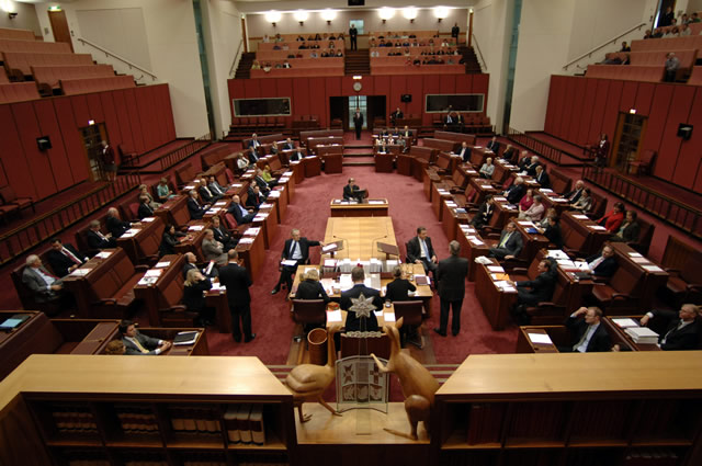 Visitors may sit in upper galleries on three sides of the chamber. The fourth side, behind the chair, is reserved for the press (Photo courtesy of AUSPIC)