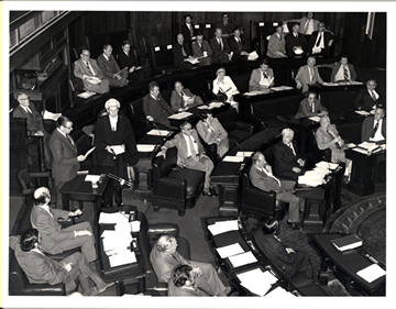 Sir Frederick Wheeler taking the oath at the bar of the Senate in 1975 (administered by the Clerk, J.R. Odgers) in relation to the overseas loans affair. On instruction, Wheeler, along with all other public servants summoned by the Senate, claimed Crown Privilege (Source: Government Information Service)