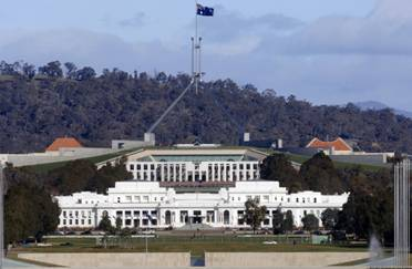 Parliament House, Canberra, showing the Australian Coat of Arms and flag