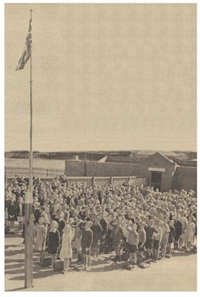 Children of Brighton-rd State School, Melbourne, salute the Union Jack in 1938