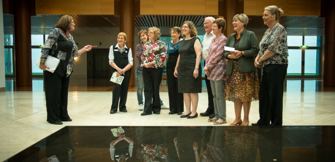 A Living Heritage Tour visits the Reflective Pool in the Members Hall at Parliament House.