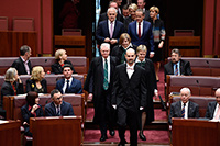 Serjeant-at-Arms leading members into the Senate chamber