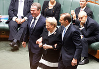 Leader of the House, Hon Christopher Pyne MP and the Prime Minister, Hon Tony Abbott MP lead the newly-elected Speaker, Hon Bronwyn Bishop MP to the Speaker's Chair.