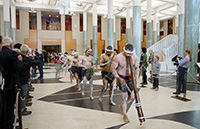 thumbnail image: Welcome to Country ceremony performers leave the Great Hall