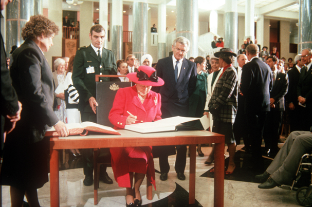 The Queen signing the visitor's book