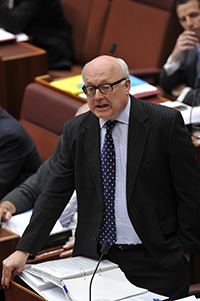 Senator the Hon George Brandis during question time