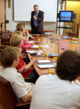 Former Clerk of the Senate speaking to schoolchildren in Parliament House
