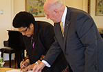The Speaker of Fiji, Dr Jiko F Luveni signs the guest book at Government House.