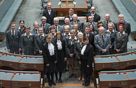 Photo of chamber support staff in the House of Representatives chamber.