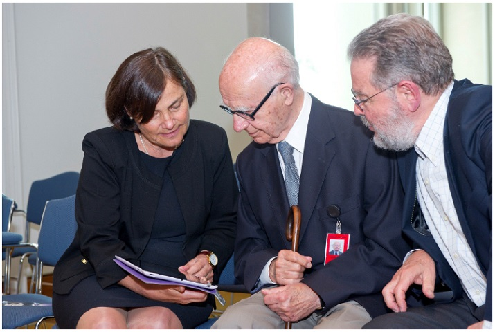 Chronology author, Joy McCann, demonstrates the chronology to Parliament House architects Romaldo Giurgola and Hal Guida