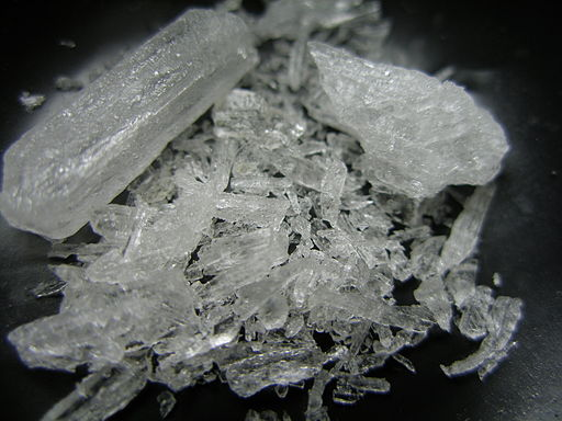 A macro shot of Crystal Methamphetamine on a black background