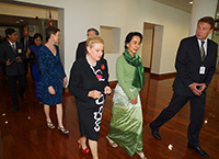 Aung San Suu Kyi and the Speaker depart the House of Representatives Chamber