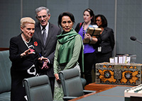 Aung San Suu Kyi with the Speaker and Clerk in the House of Representatives chamber