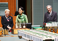 Aung San Suu Kyi with the Speaker and Clerk in the House of Representatives