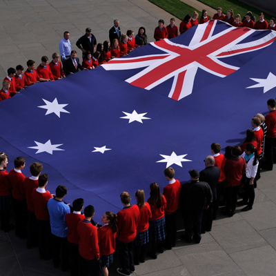 School children holding the Australian flag at Parliament House