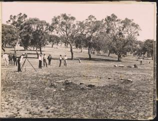 George Fuller taking the first sight in the preliminary contour survey, Camp Hill, 1909