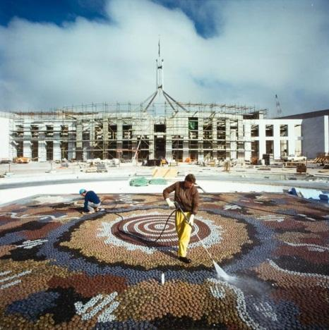 Untitled (a construction worker hosing the completed Michael Nelson Jagamara mosaic in forecourt of Parliament House)