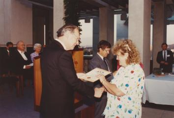 40th anniversary of first Australian citizenship ceremony held at Parliament House, Canberra. Award is presented to the recipient by Governor General, Sir Ninian Stephen, 1989