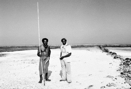 Two Aboriginal men on beach, one with fishing spear [Eddie Mabo (left) and Jack Wailu on the Island of Mer in the Torres Strait Islands]