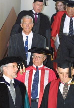 Mr Giurgola followed by Jan Utzon, making their way to the ceremony with the Dean of Architecture, Professor Gary Moore (front, left) and Professor John Carter (front, right), Civil Engineering Adjunct Professor and then Chair of the Academic Board.
