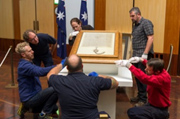 DPS staff install the Magna Carta in the Great Hall of Parliament House