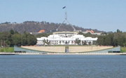 Parliament House with Lake Burley Griffin in the foreground