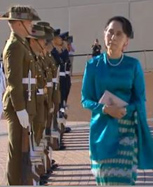Aung San Suu Kyi during a ceremonial welcome at Parliament House